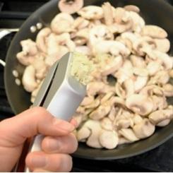 Garlic smoosher because it's satisfying and yummy!